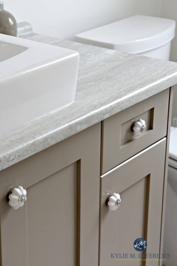 Benjamin Moore Kingsport Gray painted vanity with Travertine 180fx Silver countertop and raised vessel sink by Kylie M Interiors