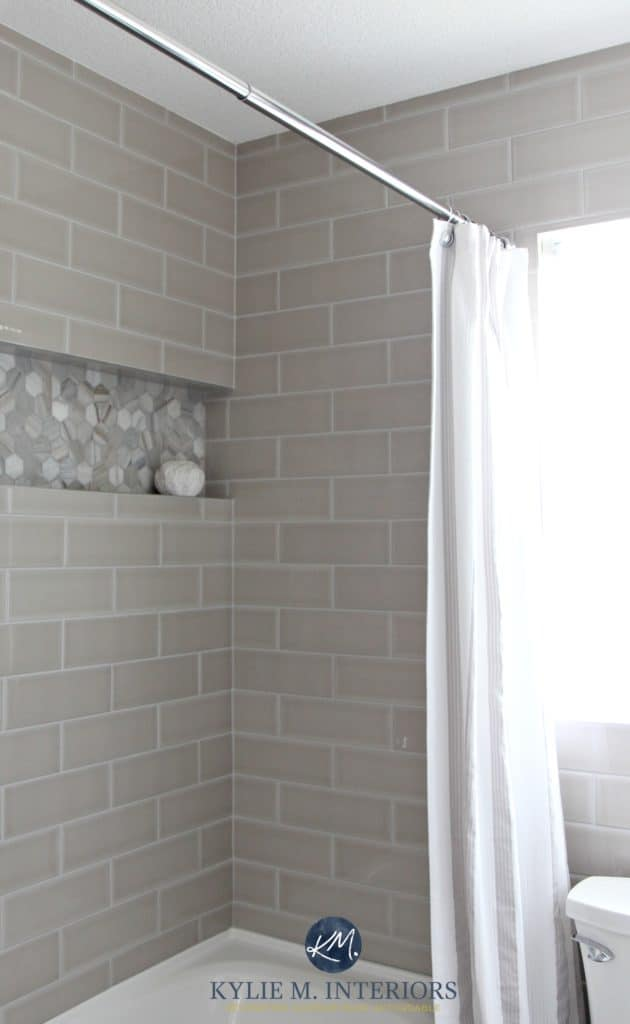 Gray subway tile shower surround with niche or alcove in hexagon shape marble tile for an accent by Kylie M INteriors