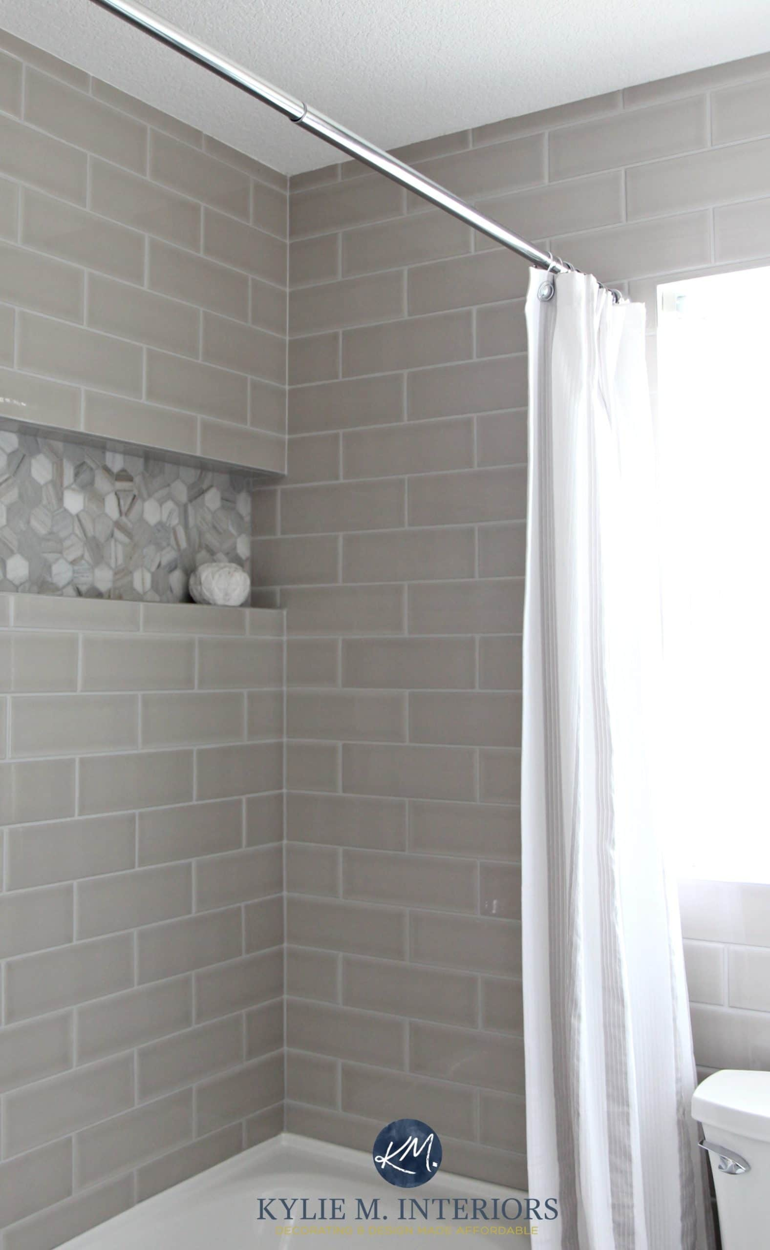 Gray subway tile shower surround with niche or alcove in hexagon ...