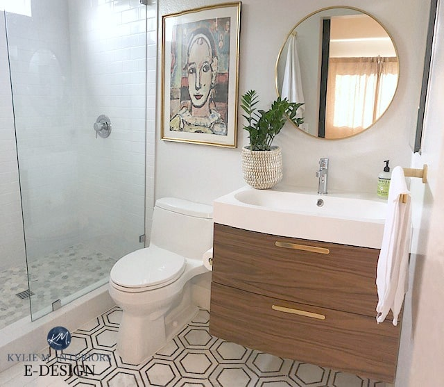 Sherwin Williams First Star in bathroom with hexagon marble floor and floatin vanity. Kylie M INteriors Edesign, onine paint color consultant