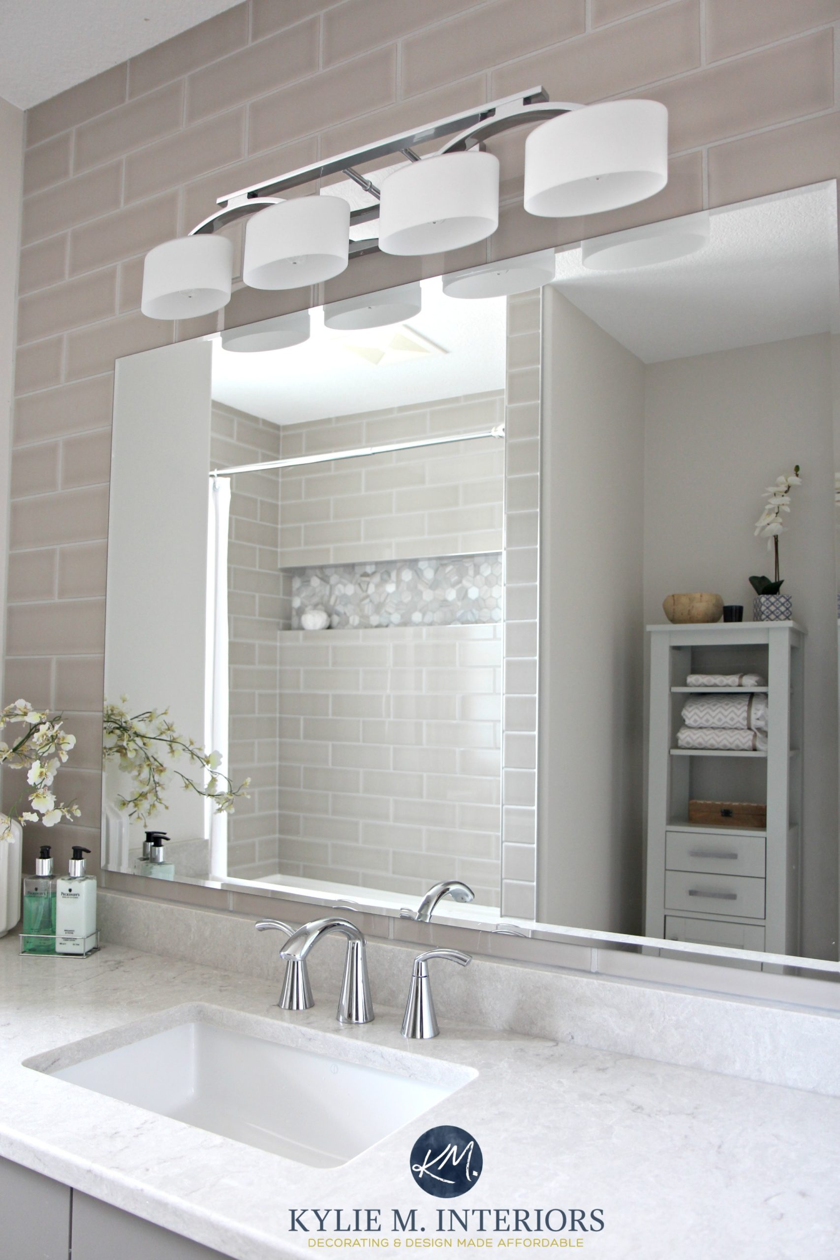Subway tile gray wall behind vanity. Quartz countertop, Bianco Drift ...