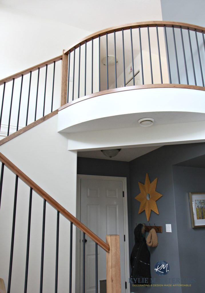2 storey entryway, foyer and stairwell with wood and metal railing. Sherwin Williams Creamy and Benjamin Moore Steel Wool. Rounded railing