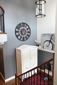2 storey foyer, entryway with round large clock, white armoire, Benjamin MOore Steel Wool and Sherwin Williams Creamy by Kylie M Interiors
