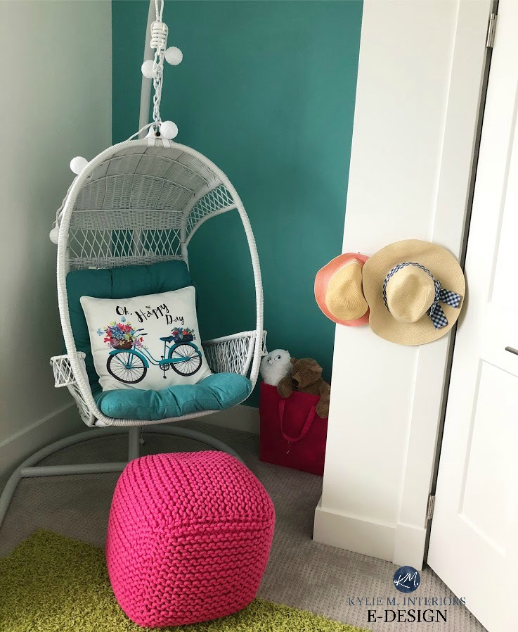 Benjamin Moore White Dove on walls and trim with teal feature wall in kids girls bedroom with swinging chair. Kylie M Interiors Edesign