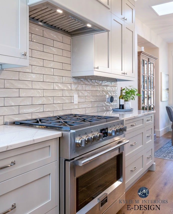 Warm gray painted kitchen cabinets with gray subway tile and dark grout and Fulgor stove in kitchen with white oak flooring. Kylie M Interiors Edesign, online paint colour consulting