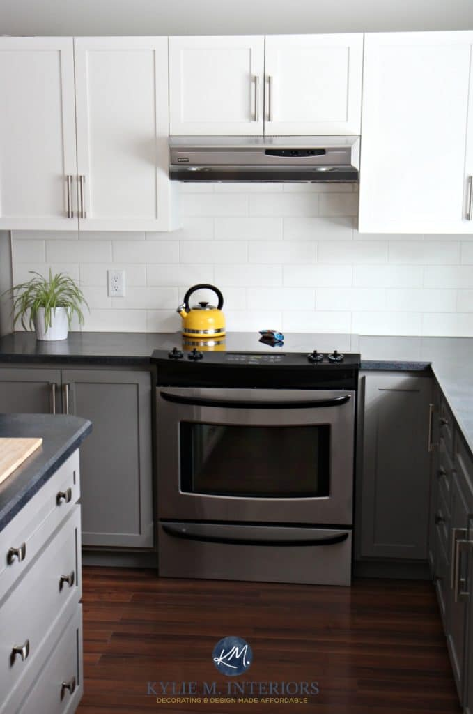 Budget friendly kitchen with painted cabinet in Benjamin Moore Chelsea Gray, white subway tile, black countertops, red toned wood floor. Kylie M INteriors E-decor