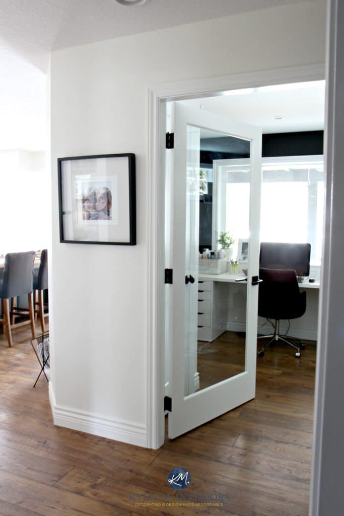 Sherwin Williams Creamy with glass french door into home office with black feature or accent wall. Kylie M Interiors E-decor and color consulting