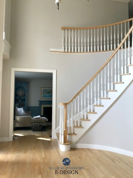 Benjamin Moore Collingwood in 2 storey foyer with yellow maple or oak flooring and white railing. Kylie M E-design, virtual online colour consulting