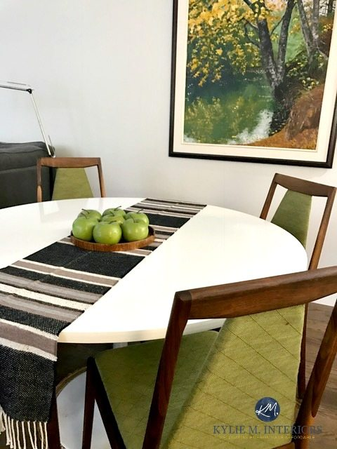 Benjamin Moore Silver Satin with green accents in a mid century modern dining room with furniture and decor. Kylie M INteriors E-design