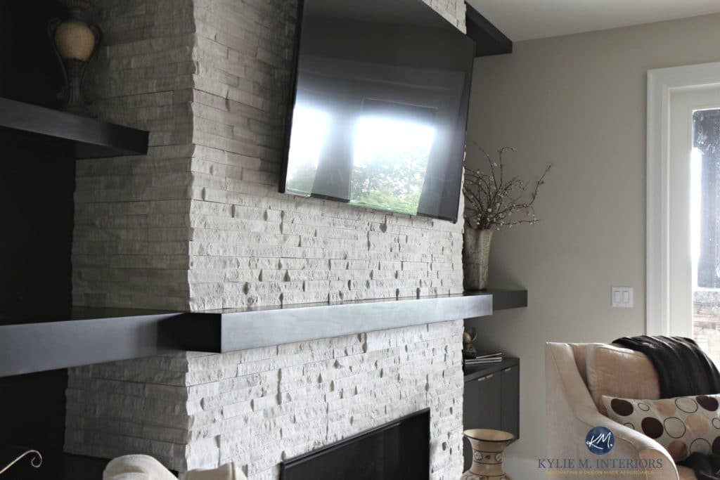 Contemporary, modern fireplace with ledgestone, tv, mantel and built in bookshelves. Kylie M Interiors E-decor, decorating and design services