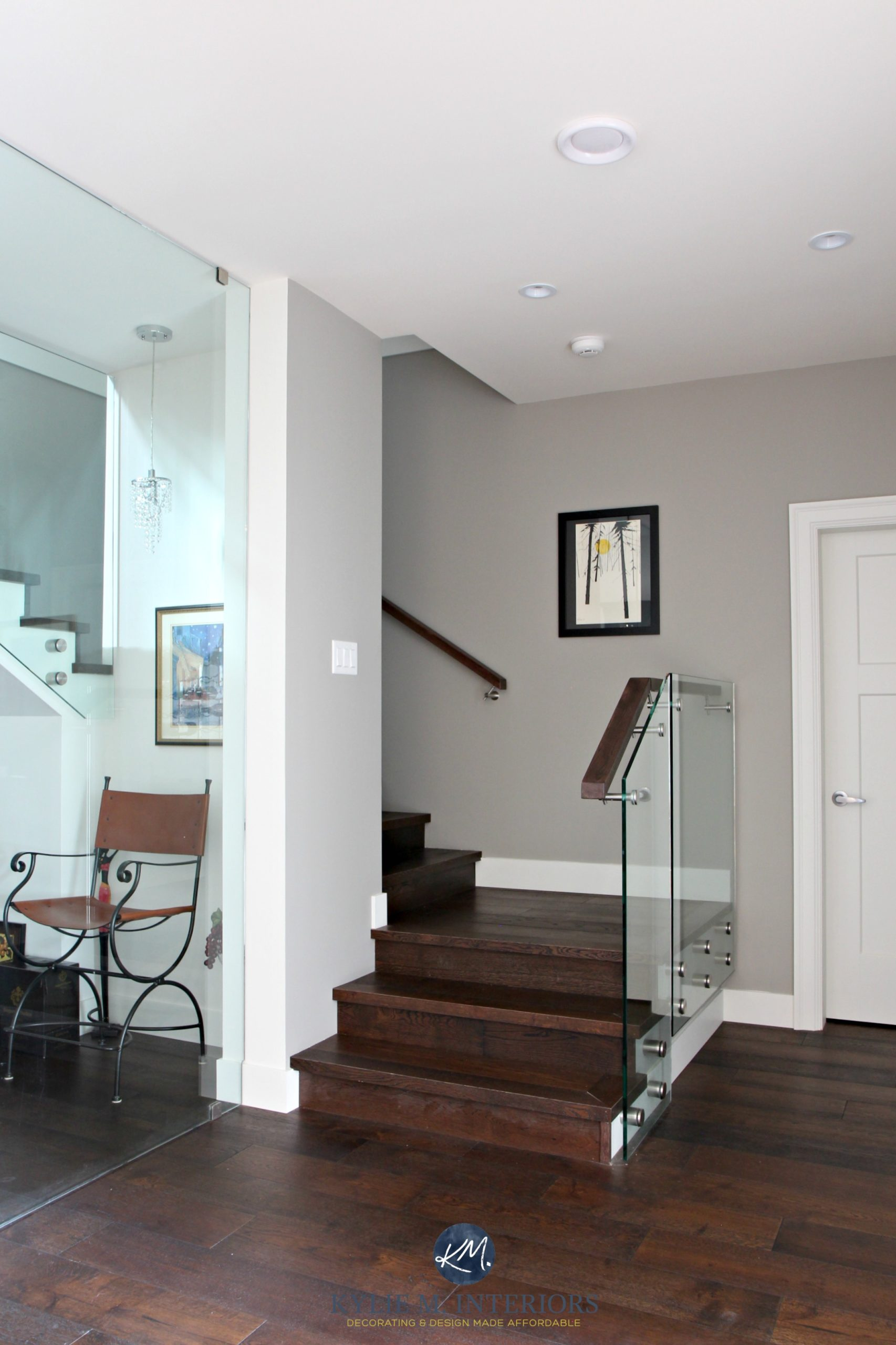 Contemporary Stairwell With Glass And Dark Wood Sherwin