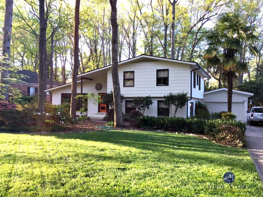 Exterior split level home with painted brick. Mid century ...