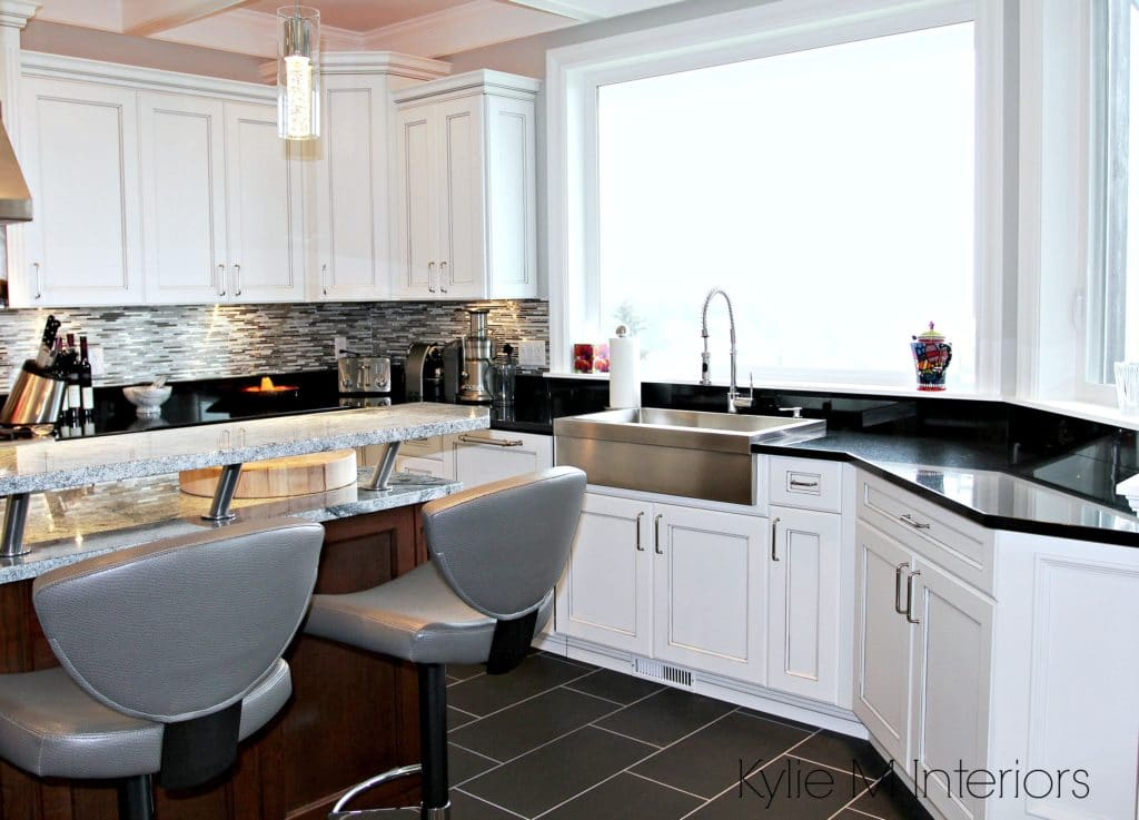 High contrast whtie kitchen with black countertops and farmhouse stainless sink. Kylie M interiors