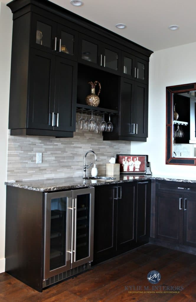Home bar or wine station with fridge and sink. Dark espresso cabinets and wood floor. Kylie M Interiors Decorating, Design and E-decor services