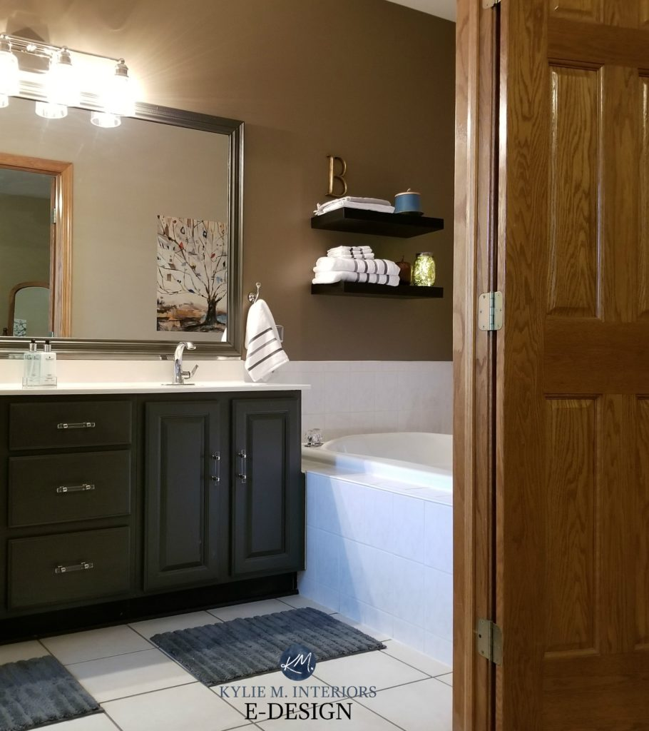 Kylie M Interiors Edesign, oak wood bathroom vanity cabinet painted a dark greige green paint colour by Benjamin Moore, Caramelized Onion by Valspar on walls. Beige tile. DIY decorating ideas