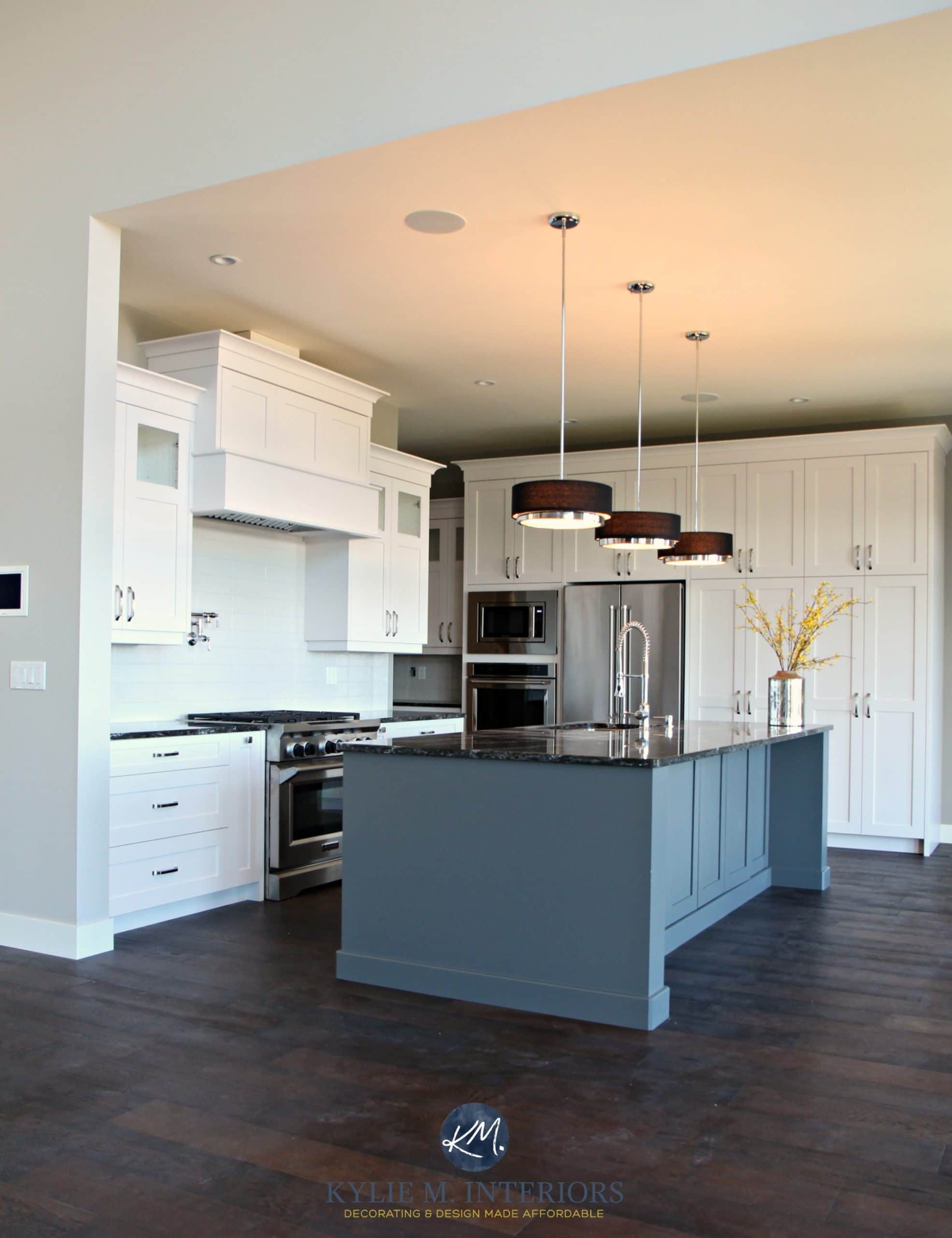 Open Layout Kitchen With White Cabinets Gray Island