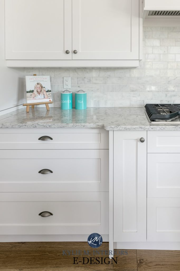 White kitchen cabinets, Sherwin Williams, marble subway tile backsplash, white, gray veined quartz countertop LG, stainless steel appliances. Angled range hood Kylie M Interiors Edesign (3)
