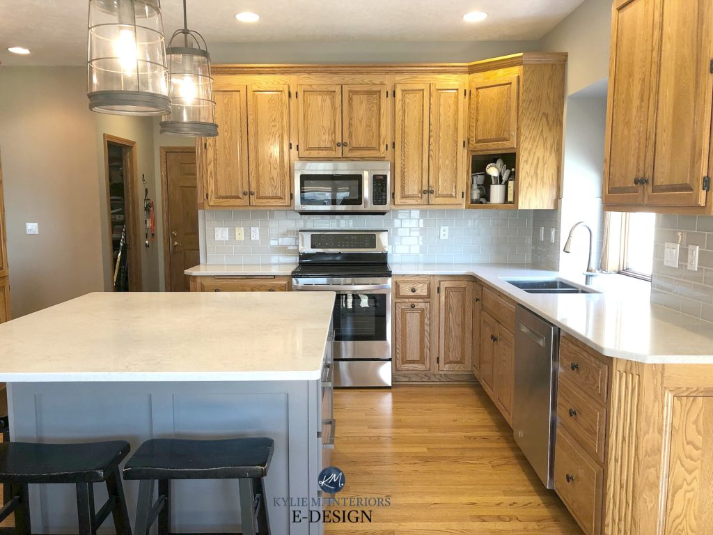 Golden oak kitchen cabinets with white q