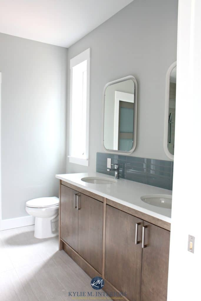 Benjamin Moore Stonington Gray on the walls of a bathroom wtih double sink and white quartz. Custom made wood vanity and tile floor. Kylie M Interiors Online Colour Consulting services - Copy