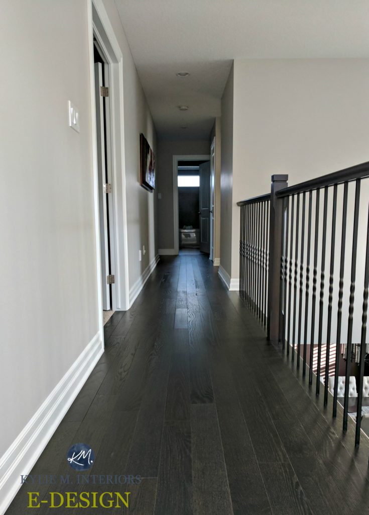 E-design and online colour consultation by color expert and blogger Kylie M INteriors. Benjamin Moore Collingwood in a hallway with dark wood flooring and black metal railing