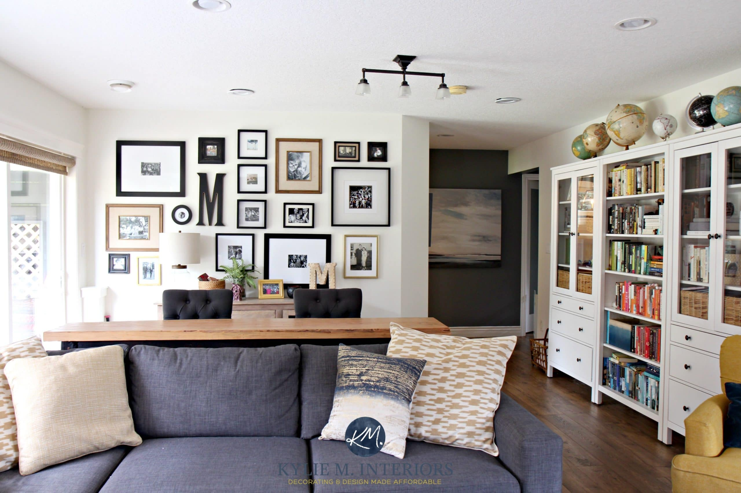 Family room with photo gallery wall gray sectional ikea for Great room wall ideas