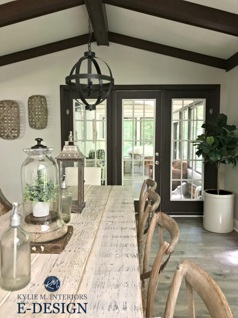 Sherwin Williams Agreeable Gray paint colour via Kylie M e-design Farmhouse style dining room with wood table, dark wood trim