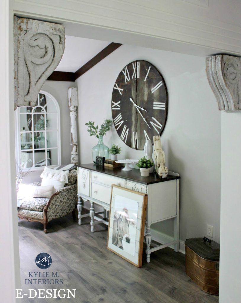 Sherwin Williams Agreeable Gray. farmhouse style, buffetclock with dark trim beams. Kylie M