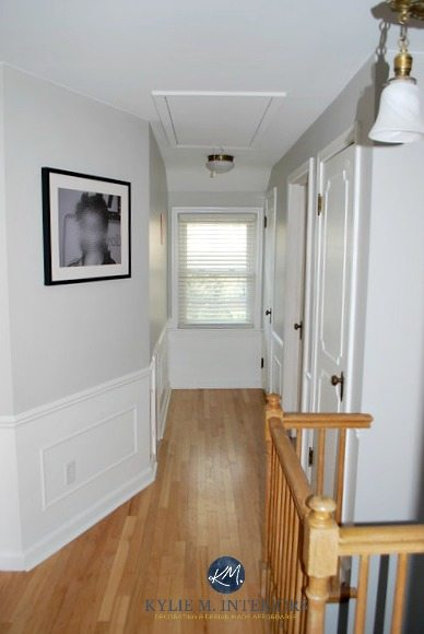 Sherwin Williams Big Chill with white wainscoting, oak flooring and stair railing, white doors in hallway. Kylie M INteriors E-design and Online or virtual color consultant