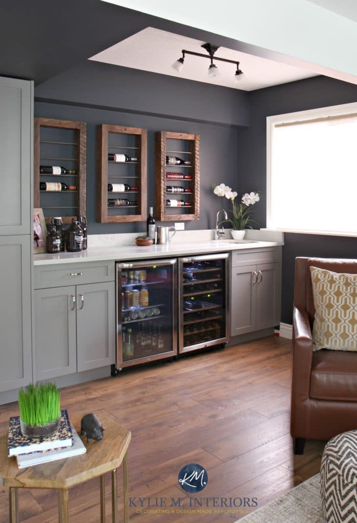 Sherwin Williams Cyberspace in home bar with reclaimed wood wine display with beer fridge and Cambria Bianco Drift countertops. Kylie M INteriors E-design