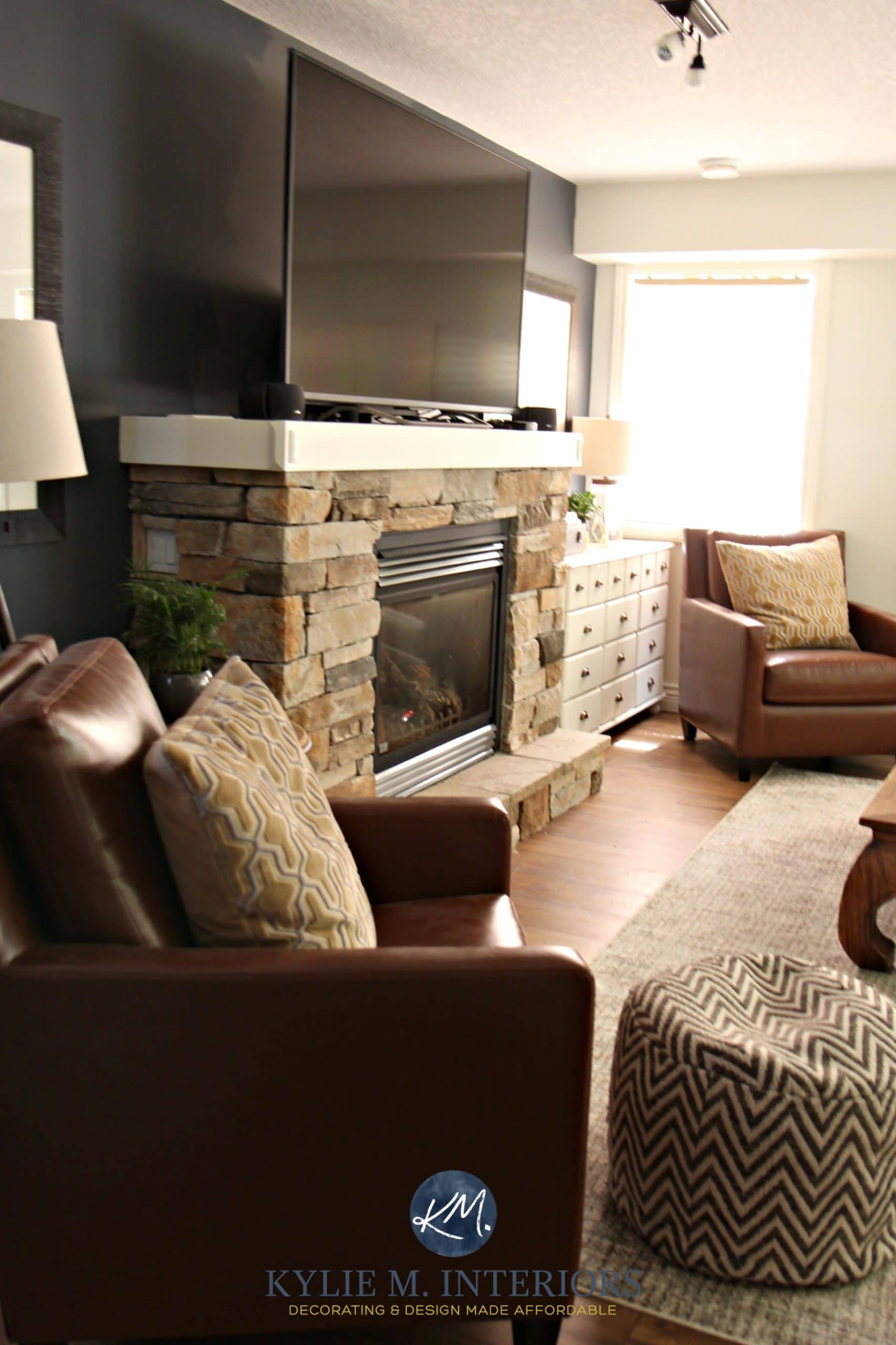 Family Room With Tv On Mantel Above Stone Fireplace With 2 Leather Accent  Chairs And Sherwin Williams Cyberspace. Kylie M Interiors E Design
