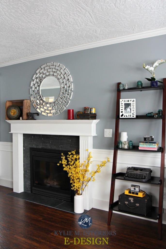 Sherwin Williams Network Gray in living room, white wainscoting, fireplace and mantle. Red toned wood flooring. Kylie M Interiors E-design and online colour consulting and blog