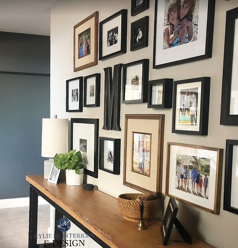 Best dark paint color for dark room. Sherwin Williams Grizzle Gray and Colonnade, Kylie M INteriors Edesign, online paint colour expert. Family photo wall gallery