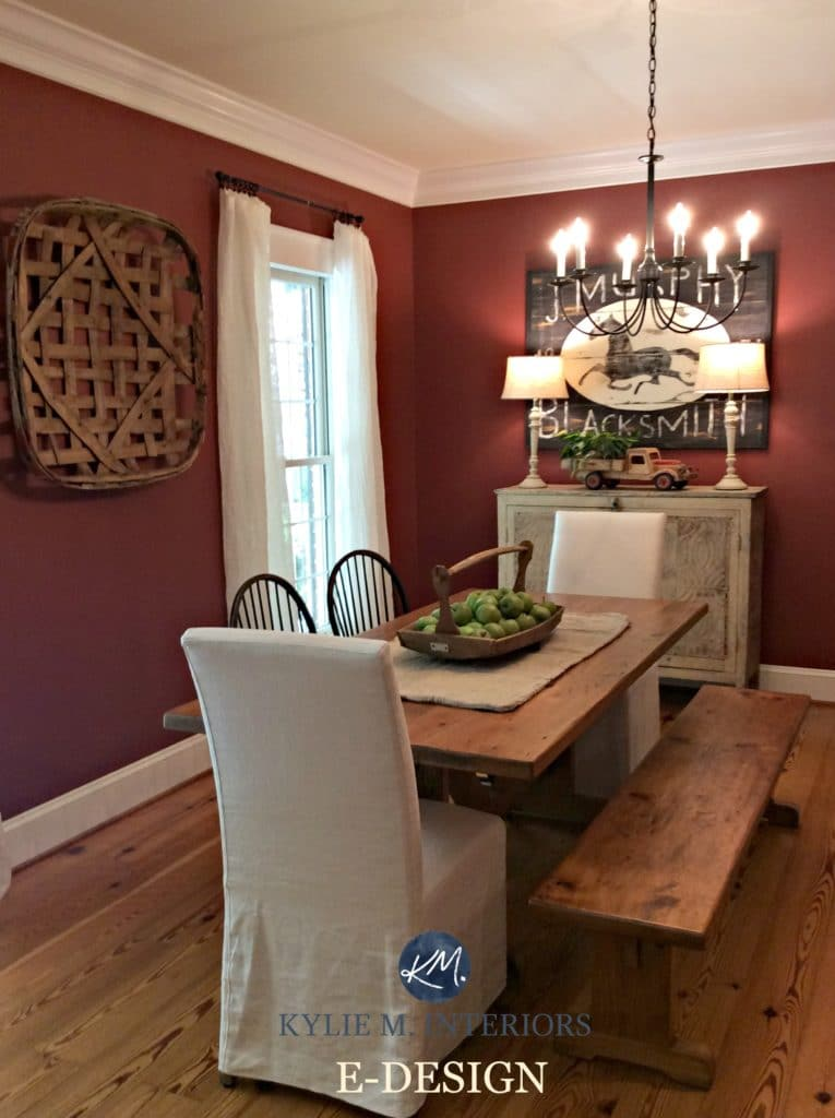 Benjamin Moore Onondaga Clay, Boxcar Red in farmhouse country style dinign room with wood floor, table and chandelier. Kylie M Interiors E-design and online color consulting and e-decor expert