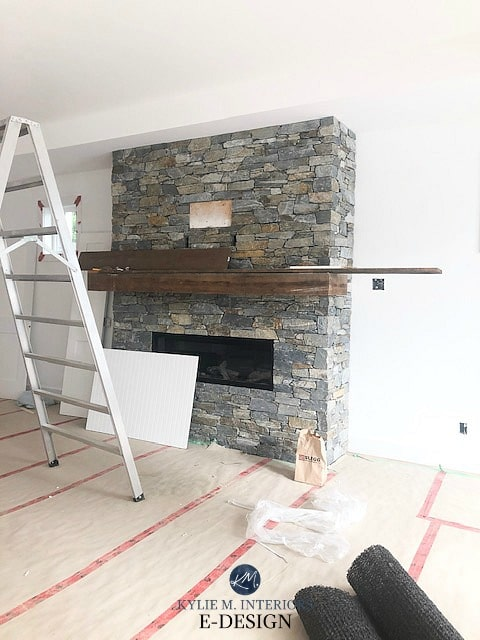 Benjamin Moore Super White with K2 stone fireplace with reclaimed wood floating mantel. Kylie M Interiors Edesign, online paint colour advice blogger