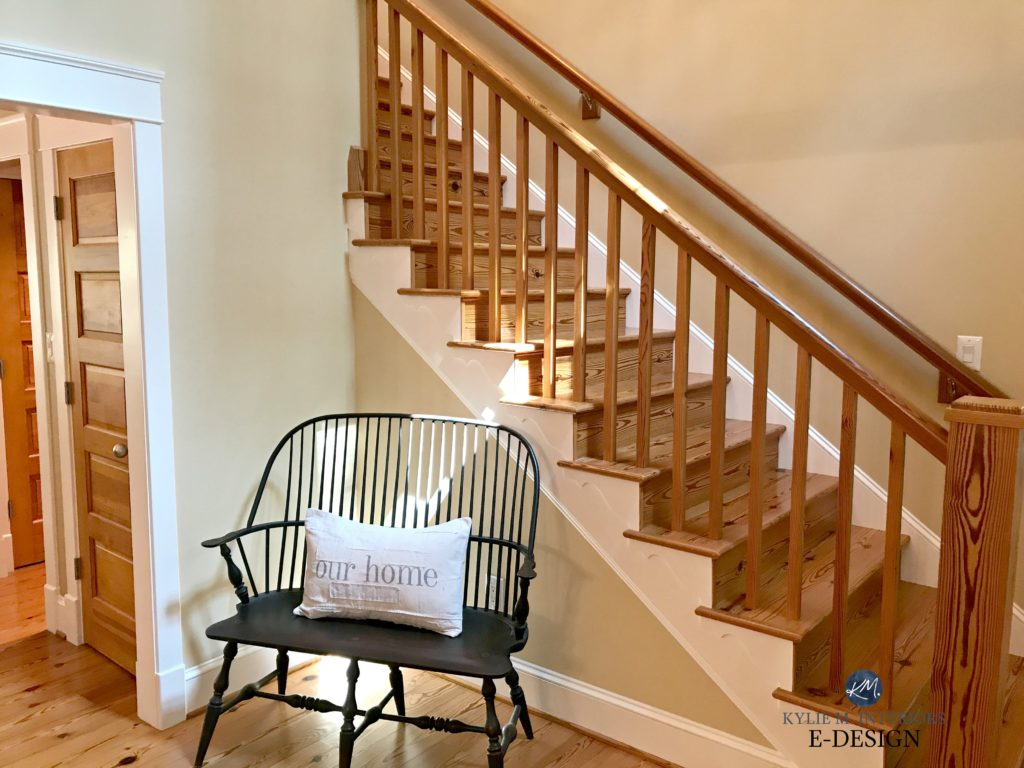 Pine and warm toned wood floor, doors, stairs and railings. Similar to oak look. Benjamin Moore Powell Buff, warm beige paint colour. Kylie M E-design, online, virtual colour consulting services