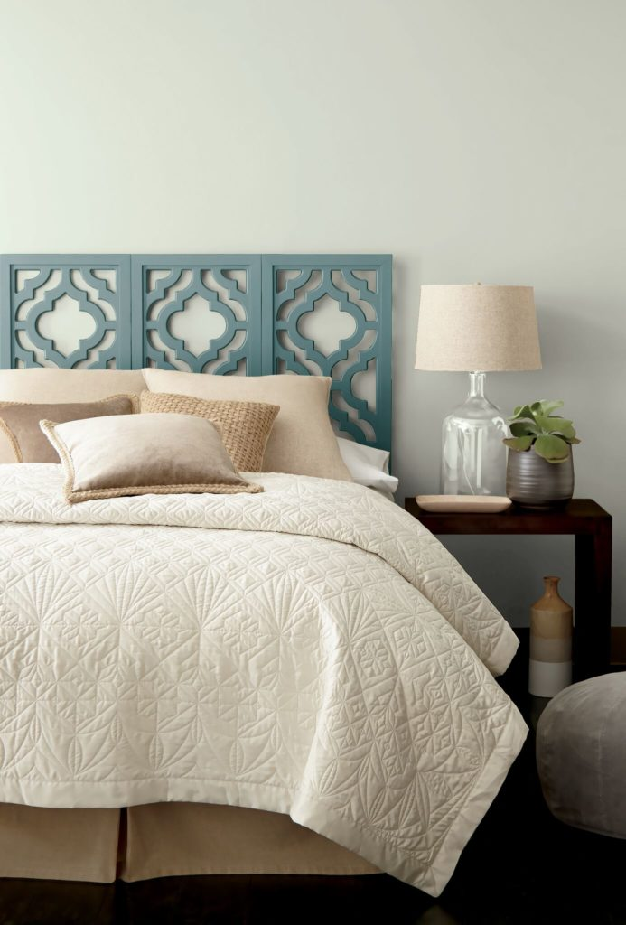 Behr In the MOment, a blue green gray paint colour on a painted bedroom headboard. Kylie M Interiors blog. Photo via Behr.