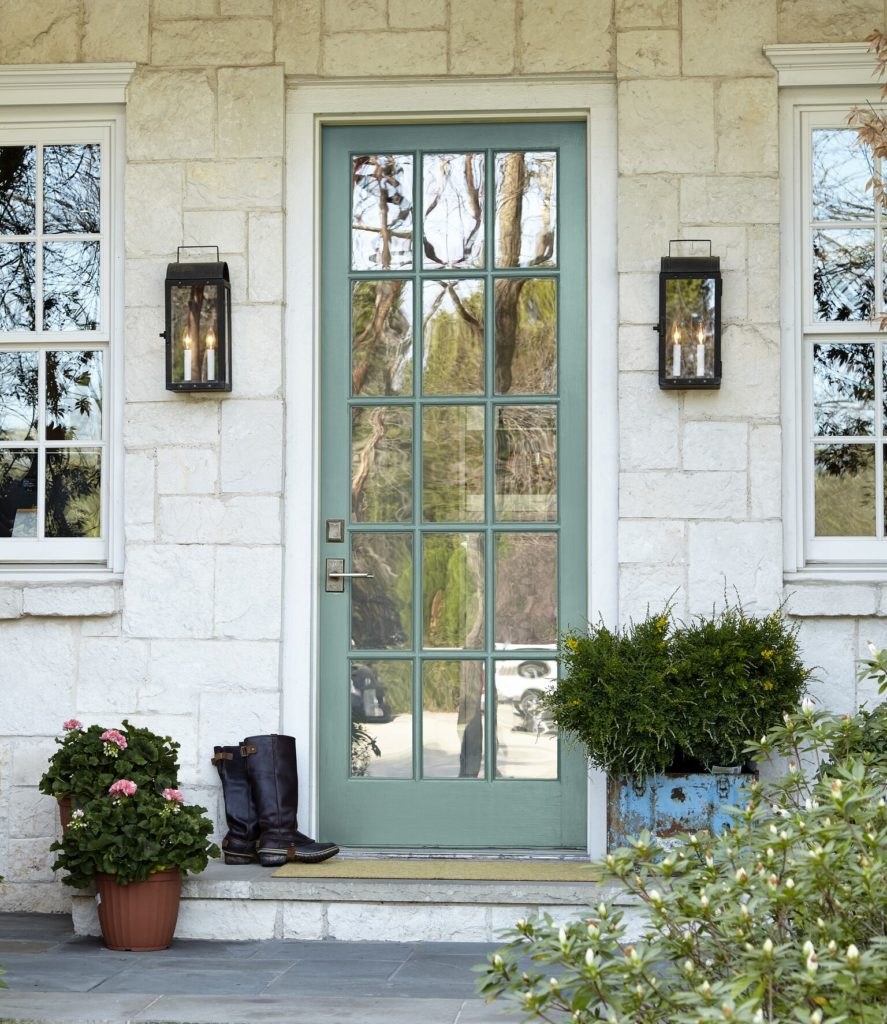 Behr in the Moment painted on a front door with white stonework. Curb Appeal. Photo via Behr. Kylie M interiors colour blog.
