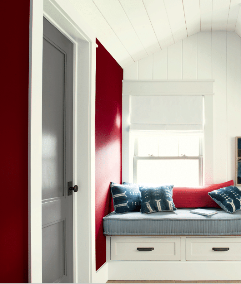 Benjamin Moore Caliente a red colour of the year in sitting area in room. Chelsea gray and off-white accents. via BM. Advice by Kylie M INteriors E-design