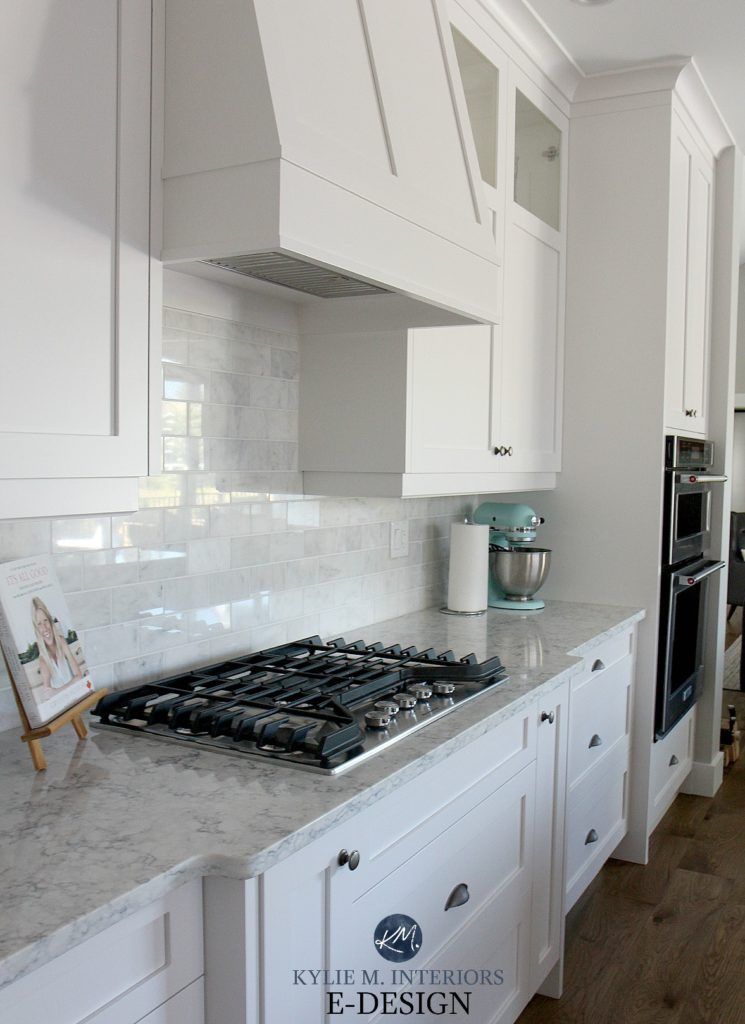 LG white quartz kitchen countertop, High Reflective White cabinets, subway marble tile backsplash. Kylie M Interiors Edesign, online paint color blogger and consultant