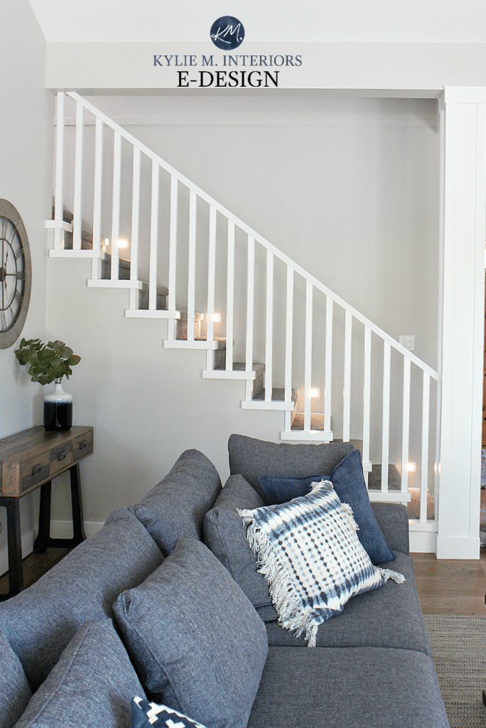 Staircase with lights, carpet, wood flooring, white railings. Stonington Gray paint color. Kylie M Interiors Edesign, online paint colour expert