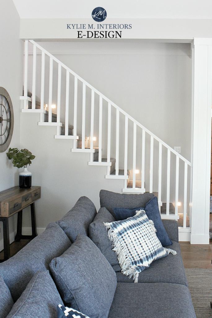 Staircase with lights, carpet, wood flooring, white railings. Stonington Gray paint color. Kylie M Interiors Edesign, online paint colour expert