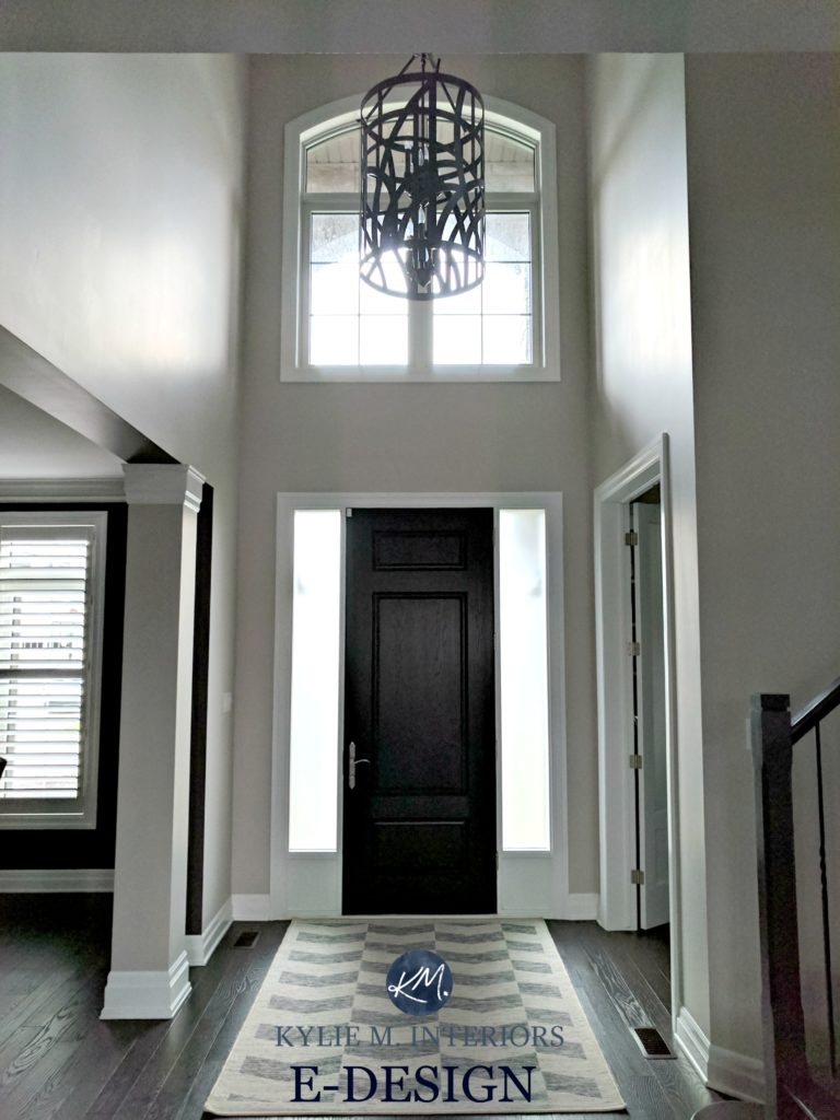 Benjamin Moore Collingwood in 2 storey entryway or foyer with dark wood door and white trim. Kylie M Interiors E-design and online color consulting