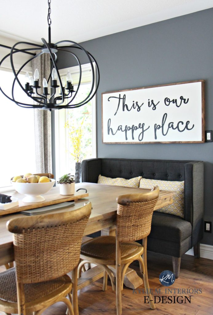 Large wood farmhouse country sign. Dining Room. Upholstered bench, wicker chairs. Benjamin Moore Steel Wool. Kylie M E-design, colour consultant