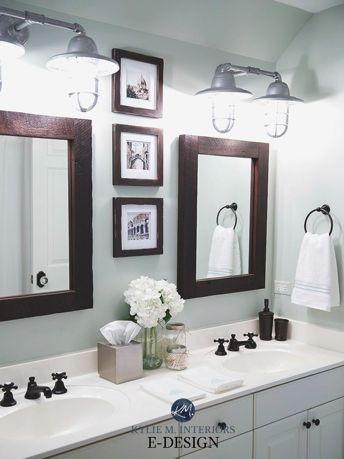 Sherwin Williams Sea Salt in a bathroom with white countertop, vanity, farmhouse bulbs, wood framed mirror. Kylie M E-design, online color consultant