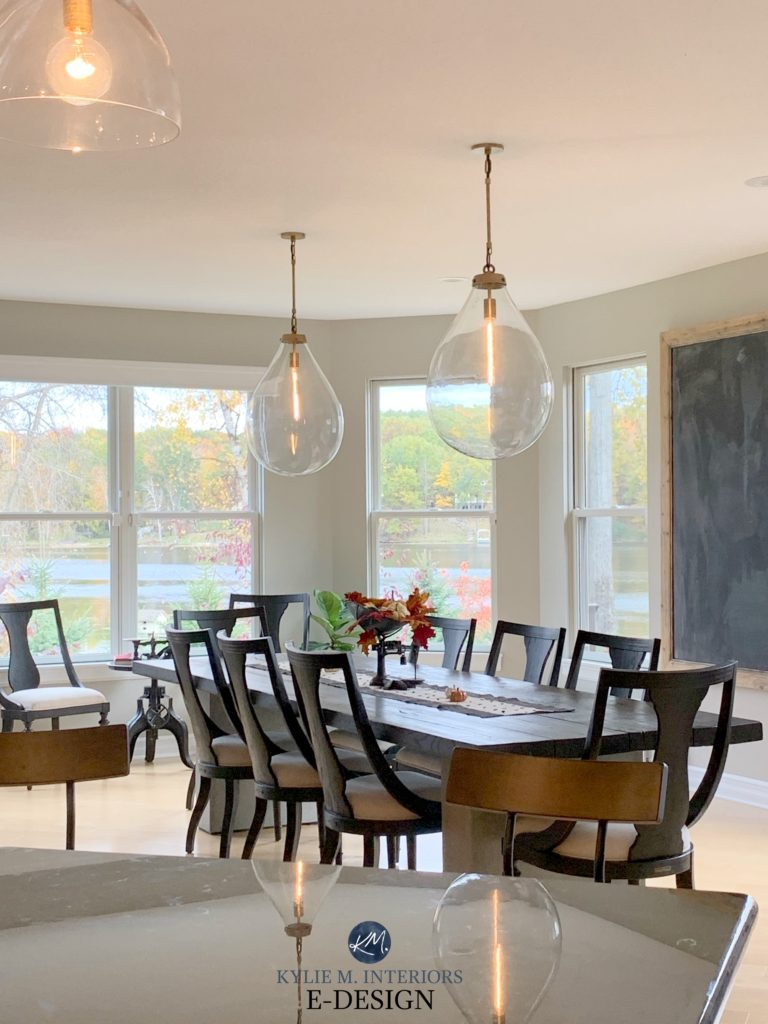 Benjamin Moore Revere Pewter in dining room with dark wood furniture and pendant lights. Best warm gray. Kylie M Interiors Edesign, client photo. Decorating blog
