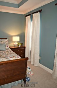 Sherwin Williams Moody Blue, master bedroom, beige carpet, white drapes, wood furniture. Kylie M E-design, online paint color consultant