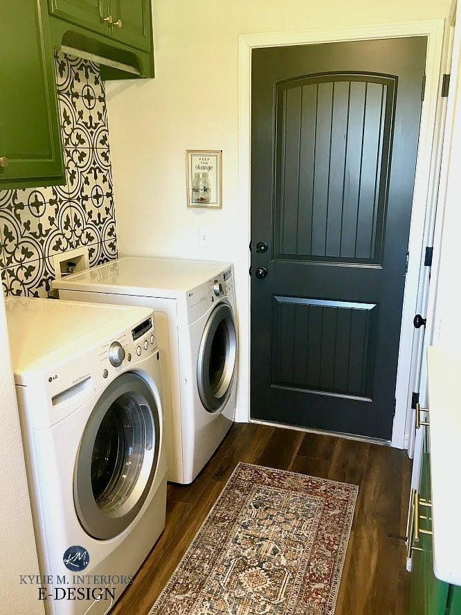 Laundry room with patterned accent wall tile, white washer and dryer, Iron Ore door and Pearly White walls. KYlie M Interiors Edesign, online paint color consulting