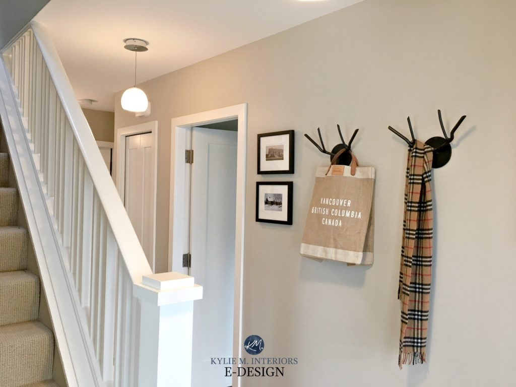 Benjamin Moore Edgecomb Gray entryway with white stair railing. Before Kylie M E-design, online color consultant