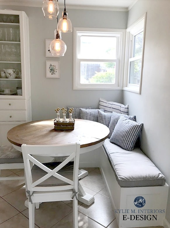 Benjamin Moore Gray Cashmere in kitchen eating nook with built in bench, cushions and round farmhouse style table. Kylie M Interiors Edesign, online paint colour blog and consulting