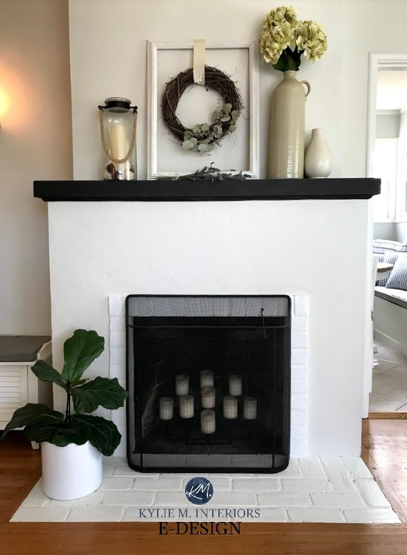 Painted stucco and brick fireplace. Painted Ballet White and White Dove with black mantel and country home decor. Kylie M Interiors Edesign, online paint color advice blog